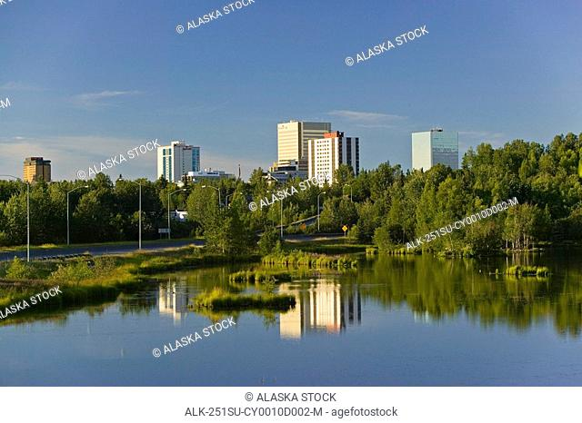 Downtown Anchorage reflects in Westchester Lagoon Southcentral Alaska Summer
