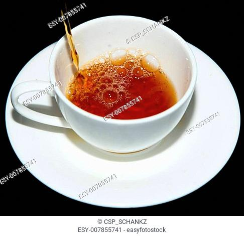 tea in a cup on a black background