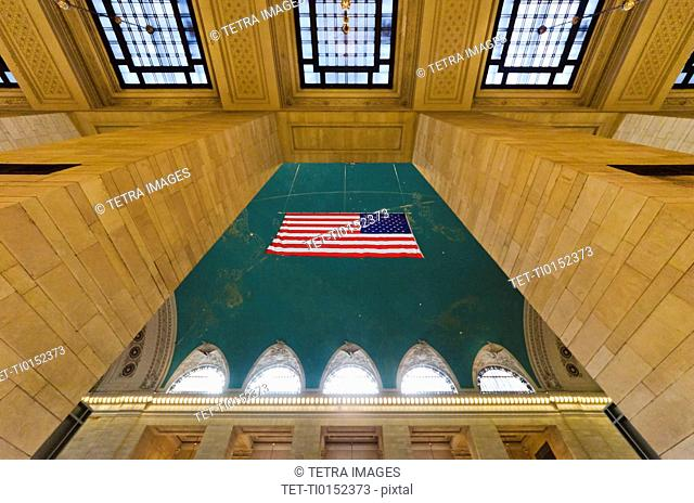 USA, New York State, New York City, Interior of Grand Central Station with American flag