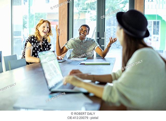 People working at conference table in office