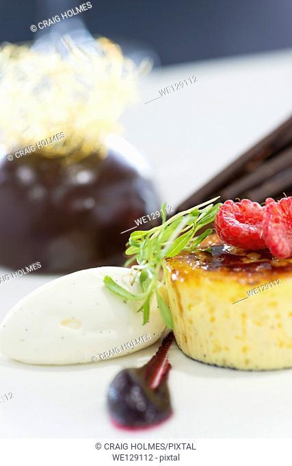 Trio of desserts, including Crème brûlée, chocolate flan and chocolate bombe