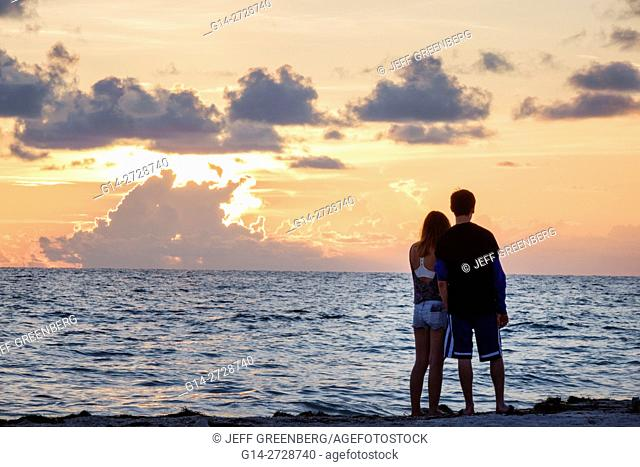 Florida, Gulf of Mexico, Gulf Coast, Anna Maria Island, Bradenton Beach, beachfront, sunset, ocean, water, girl, boy, teen, couple, romantic, silhouette, clouds