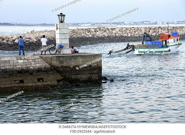 evening fishing, Bensafrim river connecting with Atlantic Ocean in Lagos, Algarve, Portugal, Europe