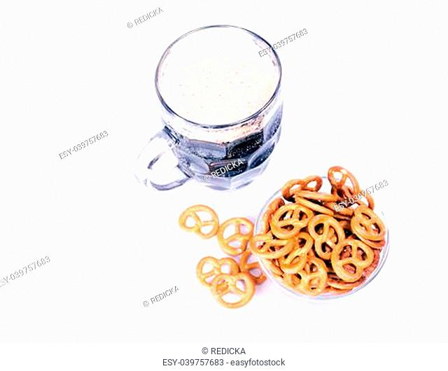 mug of beer and pretzel snack on a white background. horizontal format