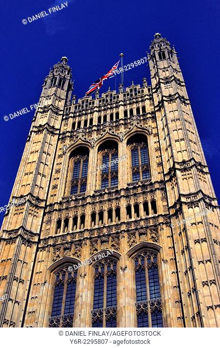 The Victoria Tower of the Houses of Parliament in Westminster, London, England, on a sunny Summer day
