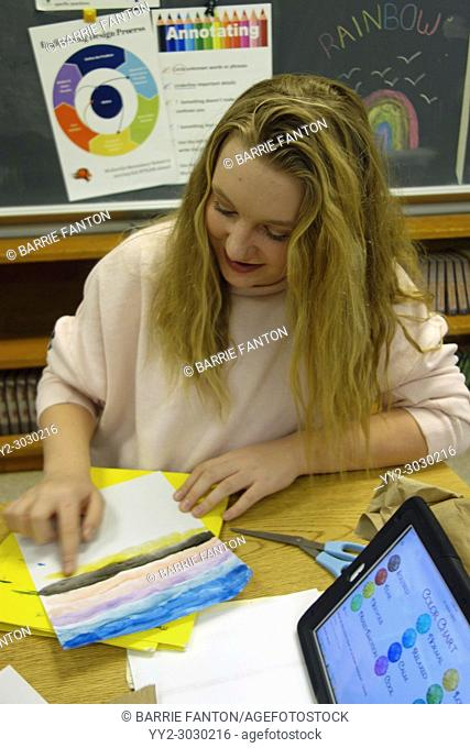 7th Grade Girl Painting Emotions in English Class, Wellsville, New York, USA