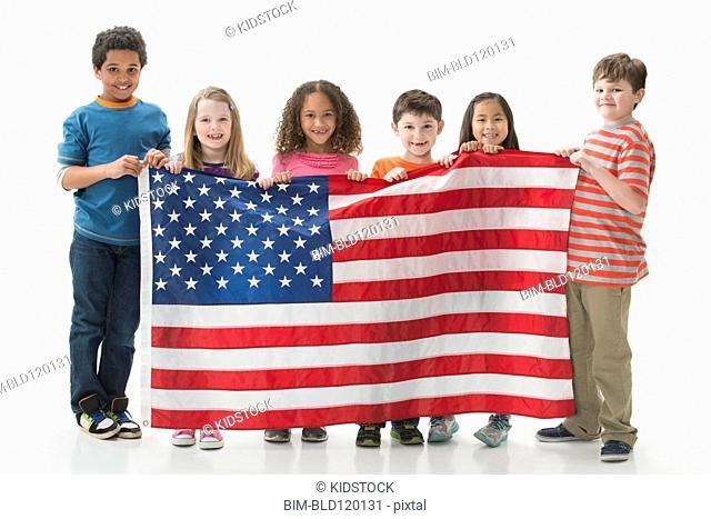 Children holding American flag