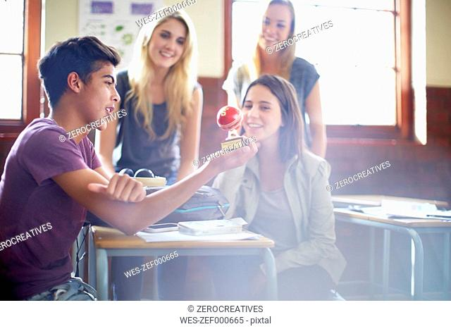 Students in classroom with globe