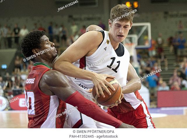 Germany's Tibor Pleiss (L) plays against Portugal's Carlos Andrade during the international basketball match Germany vs. Portugal at S-Arena in Goettingen
