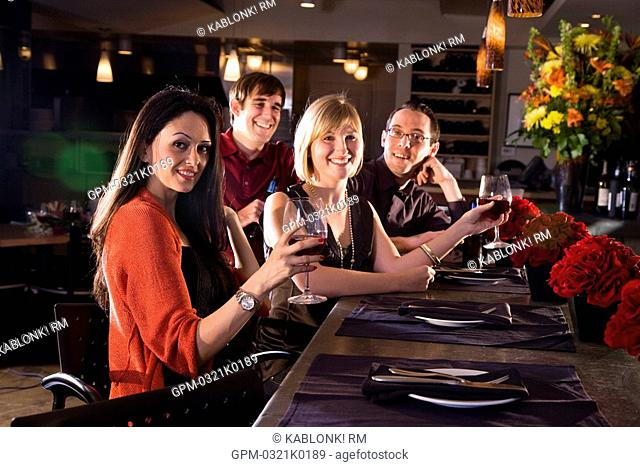 Portrait of young adult friends hanging out at restaurant