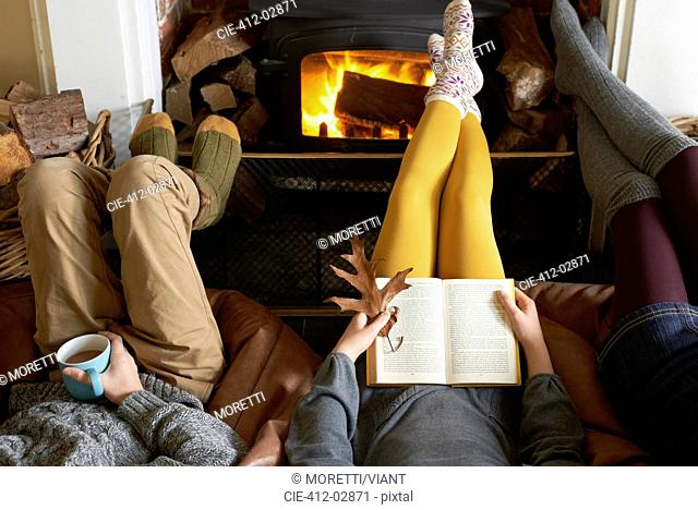 Children relaxing by fire