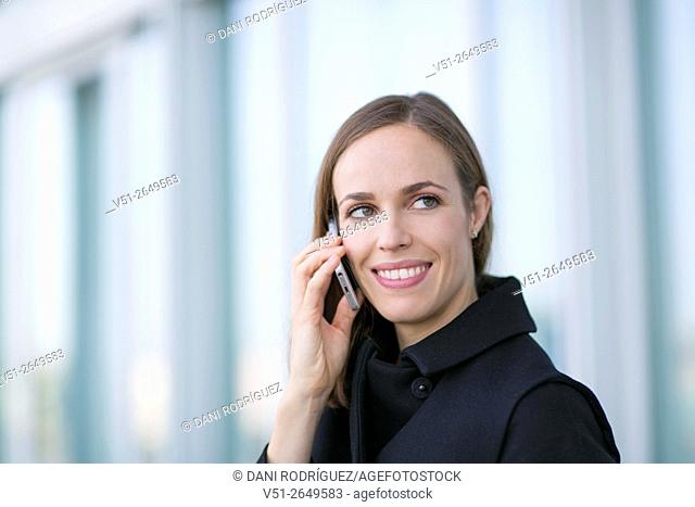 Pretty woman making a call outdoors