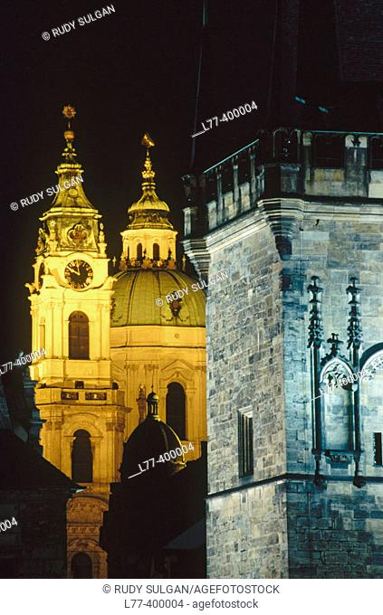 Saint Nicholas baroque church and tower at fore. Prague, Czech Republic