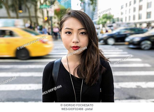 USA, New York City, Manhattan, portrait of serious looking young woman