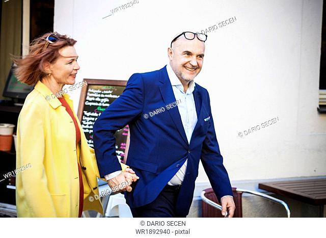 Senior couple holding hands, Munich, Bavaria, Germany