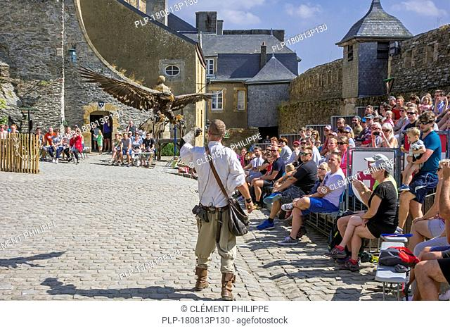 Tourists watching falconry / bird of prey show in the Château de Bouillon Castle, Luxembourg Province, Belgian Ardennes, Belgium