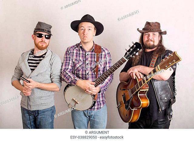 trio of musicians with a guitar, banjo and harmonica