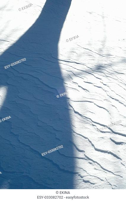 snow texture. atmospheric water vapor frozen into ice crystals and falling in light white flakes or lying on the ground as a white layer