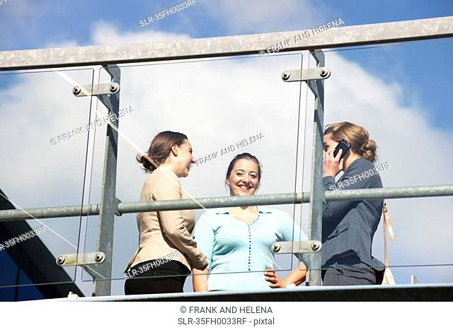 Businesswomen talking on walkway