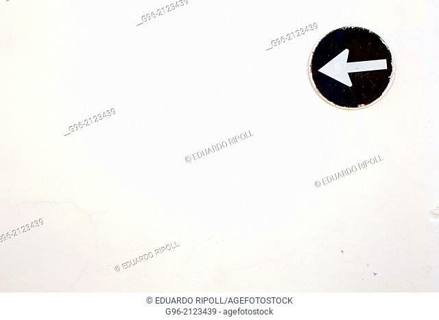 Sign on a white wall