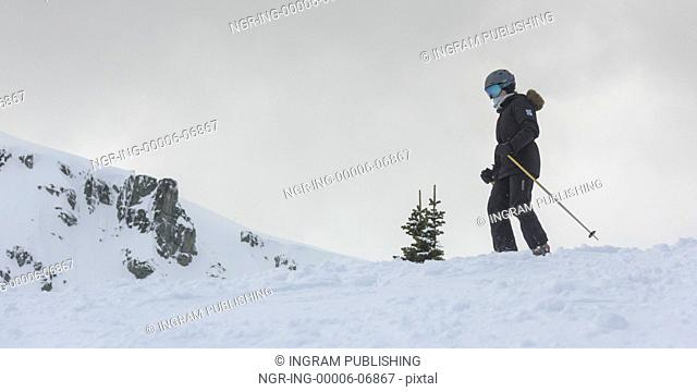 Skier on snow covered mountain, Whistler, British Columbia, Canada