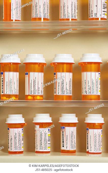 STILL LIFE. Riverwoods, Illinois. Bottles of prescription drugs on shelves, bathroom medicine cabinet