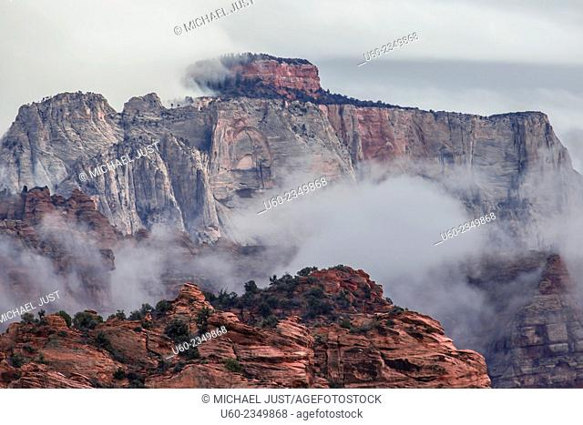 A storm passes through West Temple at Zion National Park, Utah
