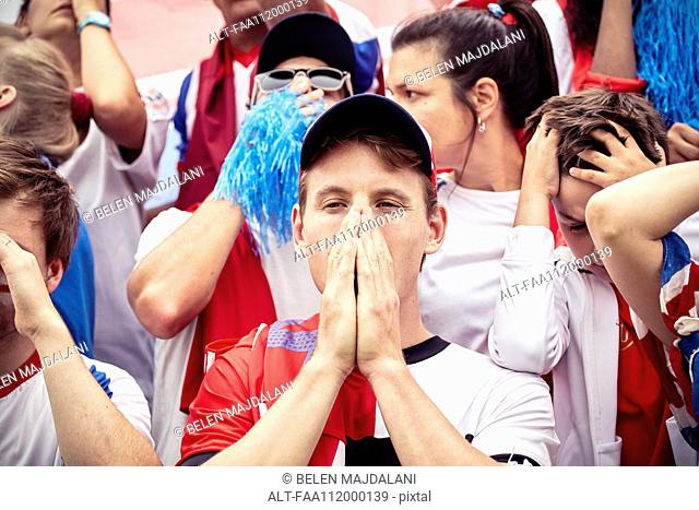 Football fans expressing disappointment at football match
