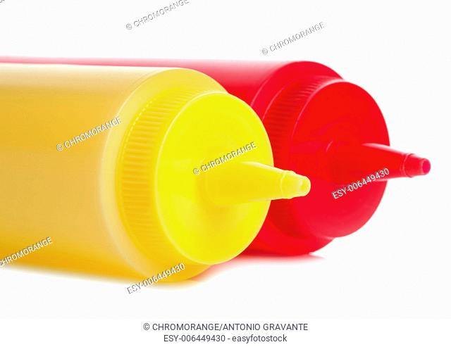 A mayonnaise and tomato ketchup bottles isolated on white background