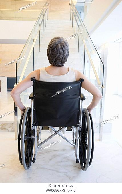 Rear view of a businesswoman sitting on a wheelchair
