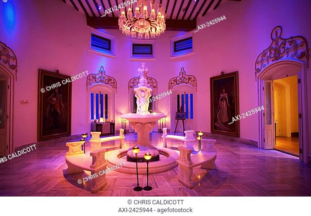 A room glowing with pink light in Falaknuma Palace; Hyderabad, Andhra Pradesh, India
