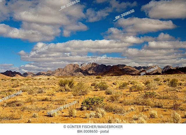A blue sky with white clouds over the mountainous desert landscape, Richtersveld Transfrontier National Park, Northern Cape, South Africa