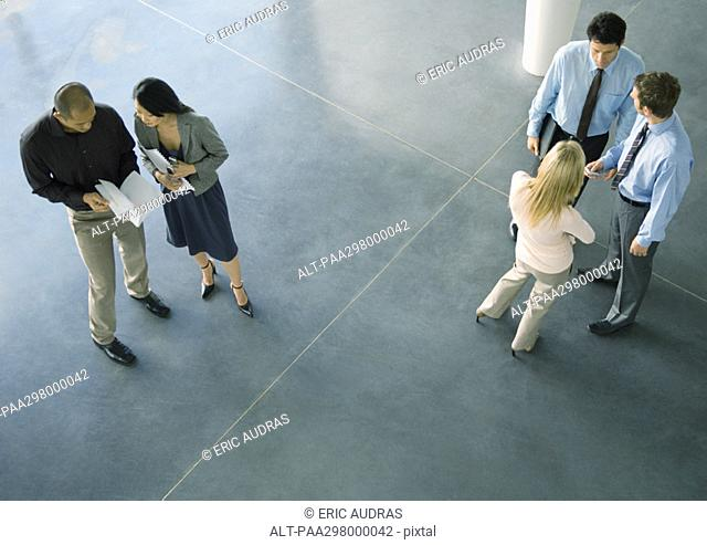 Businesspeople in lobby, high angle view