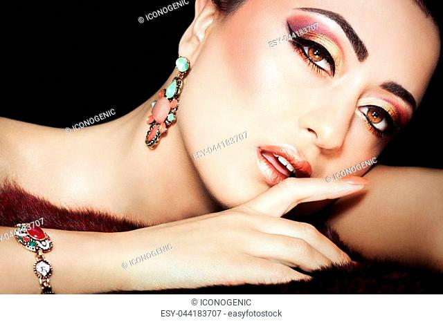 Beautiful exotic woman with excuisite Arabic glitter based makeup