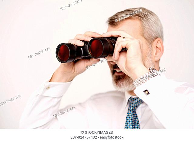 Senior businessman viewing through binocular