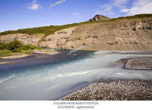 'Hvita' glacier river and 'Nordlingafljot' fresh-water river join up at this river junction  Husafell, West Iceland