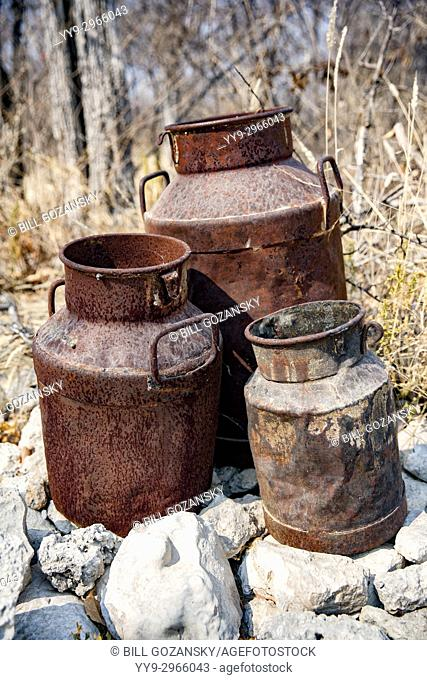 Rusted tin cans - decorative artifacts at Tamboti Luxury Campsite, Onguma Game Reserve, Namibia, Africa