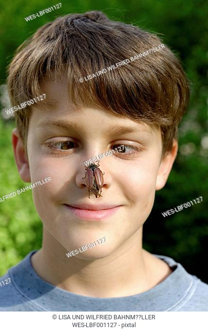 Boy with maybug on his nose