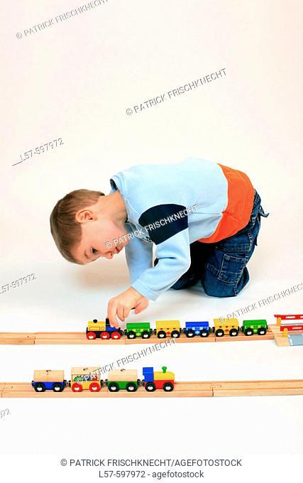 boy playing with toy, toy railway, studio, Oetwil am See, Zuerich, Switzerland