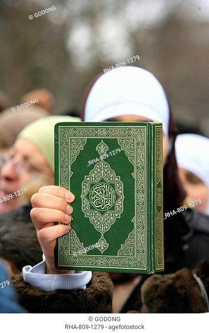 Koran being held during a Muslim demonstration, Paris, France, Europe