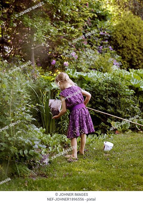 Girl with bag net in garden