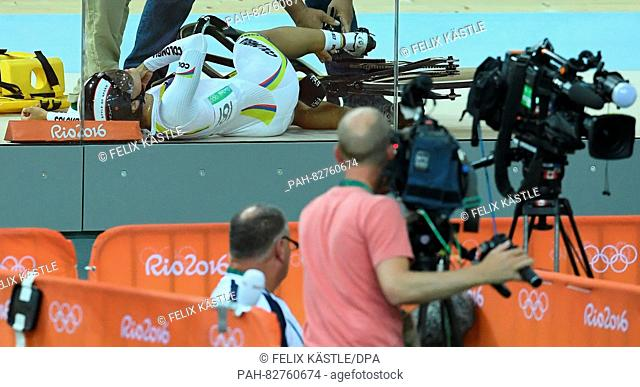 Martha Bayona Pineda of Colombia gets medical assistance after crashing during the Women's Keirin Second Round of the Rio 2016 Olympic Games Track Cycling...