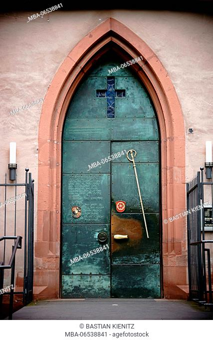 Mainz, Germany, iron door of the entrance to the St. Stephan church with engraved Latin words
