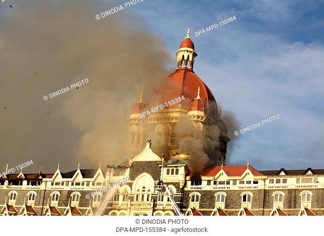 Smoke emits from Taj Mahal Hotel during terrorist attack by Deccan Mujahideen ; Bombay Mumbai ; Maharashtra ; India 27-November-2008
