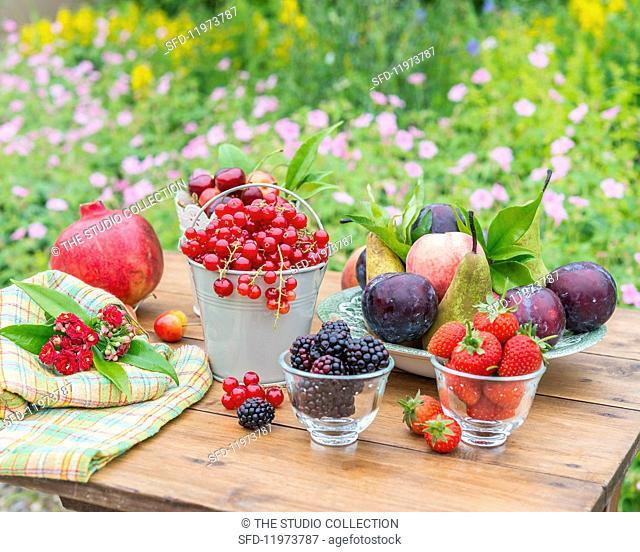 An arrangement of fruit on a garden table