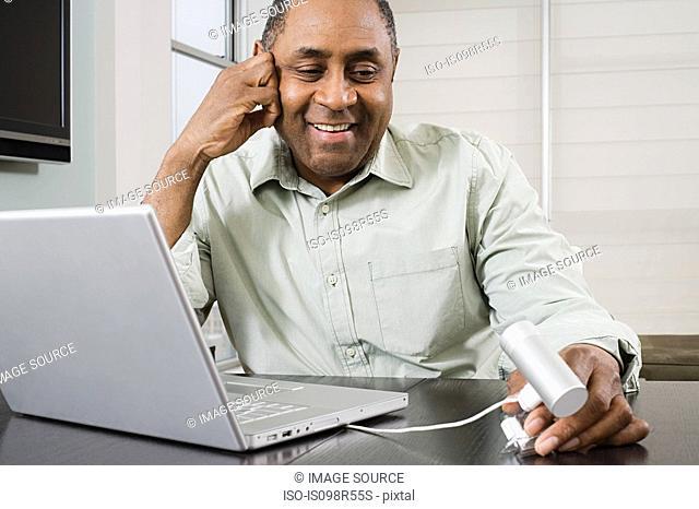 Mature man using webcam
