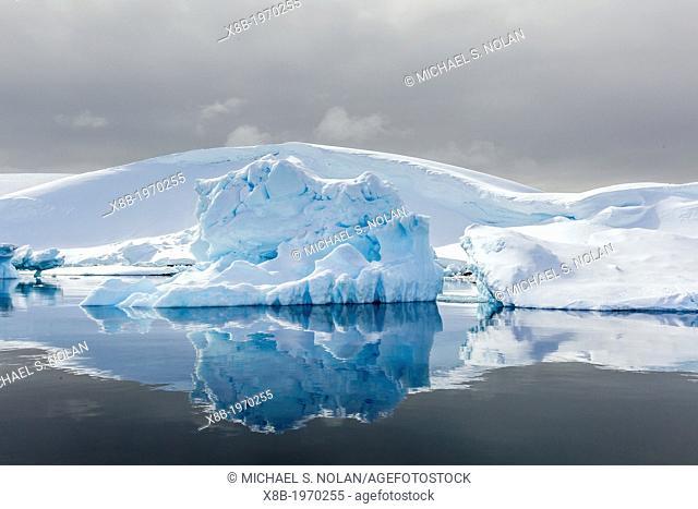 Snow-capped mountains surround the Enterprise Islands, Antarctica, Southern Ocean