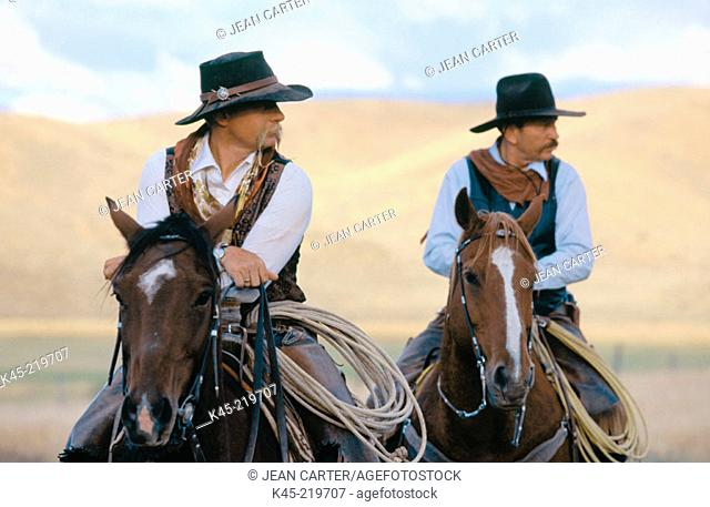 Cowboys on horses. Ponderosa Ranch. Central Oregon. USA