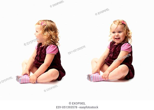Young little girl with curly hair in purple dress sitting over isolated white background