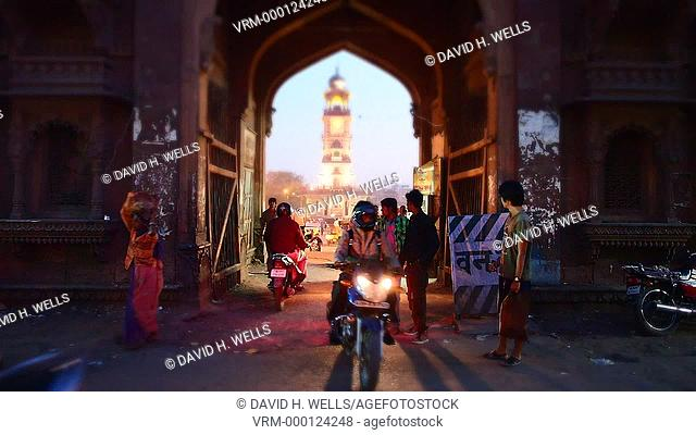 Crowded street and traffic sign, clock tower in background, Jodhpur, Rajasthan, India